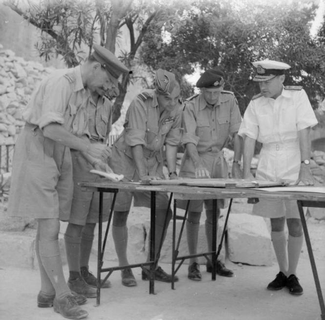 Field Marshal Bernard Montgomery along with Admiral Sir Andrew Browne Cunningham C-in-C Mediterranean outside the LWR with other RAF and military personnel in 1943